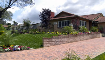 Block pavior driveway complimented with landscape gardens and new retaining wall