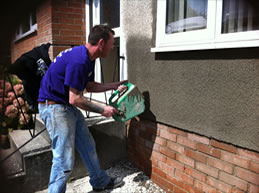Repairing the render to the front of a property in Totnes